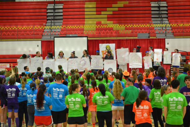 Image from KC Mini-THON Facebook // Captains from KC Mini-THON 2015 reveal the amount of money raised for the Four Diamonds Fund.