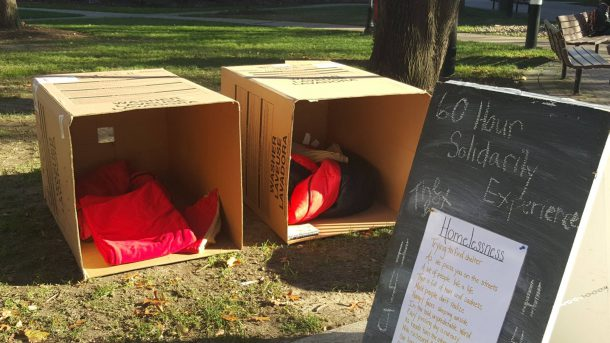 """Image from King's College Facebook Page Hunger for Justice Week featured many programs designed to educate the community about the realities of homelessness. Pictured here are the boxes used during the """"60 Hours of Solidarity"""" event. Students took turns staying in the boxes to raise awareness of homelessness."""
