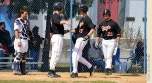Chris Sweeney touches home plate after earning his 200th hit. Photo Credit: King's College Athletics