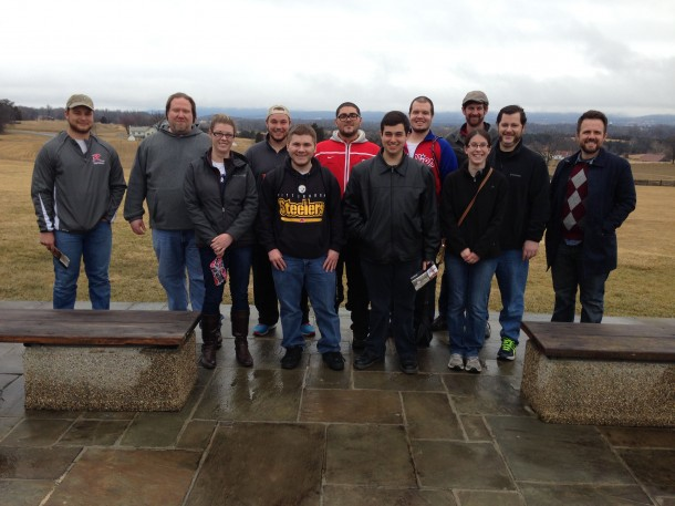 Image courtesy of Dr. Dan Clasby Students in Dr. Thomas Mackaman's American Civil War class, along with Mackaman and Dr. Daniel Clasby, pause for a photo outside the visitors' center at the Antietam battlefield.