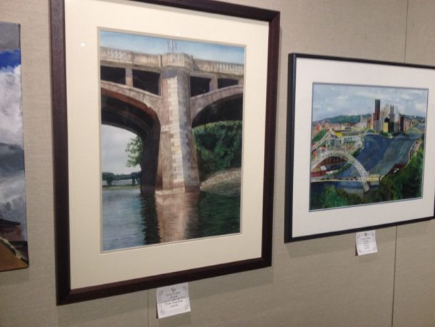 "Amy Higgins//The Crown ""Market Street Bridge,"" a watercolor, by Coughlin High School junior Emily Andrews (left) and a watercolor entitled ""Pittsburgh"" by homeschool senior Caroline Majeski are two of the many artworks displayed in the Widmann Gallery as part of the Emerging Artists Exhibit."