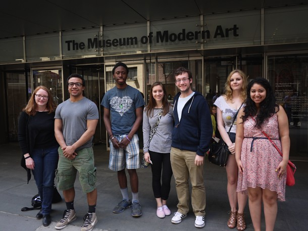 Image courtesy of Dr. Noreen O'Connor From left to right: Dr. Noreen O'Connor, Eric Seals, Ide Thompson, Sarah DeMace, Robert Kehler, Molly McMullen, Cecelia Rodriguez visit the Museum of Modern Art to visit the Jacob Lawrence Migration exhibit.