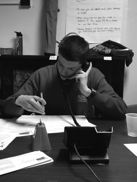 Image courtesy of John Flynn First-year student John Flynn works diligently with the phones, as he talks with an alumnus.