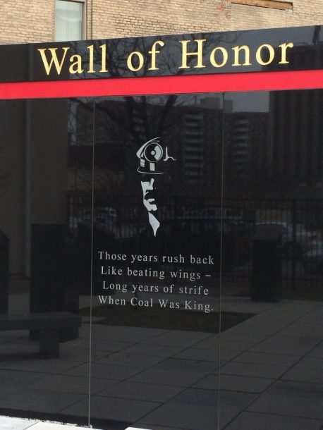 """Image courtesy of Owen Vaughn The """"Wall of Honor"""" at King's on the Square is a memorial to local coal miners. The memorial, donated by King's alum and former board member James Burke, serves a reminder of both King's College's and Wilkes-Barre's history."""