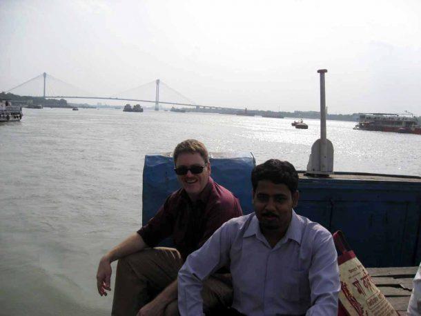 Image courtesy of Dr. Cristofer Scarboro Dr. Cristofer Scarboro and Dr. Pankaj Chakraborty on the Hooghly River, near Kolkata.